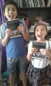 Jer and Lina with Mama's first book!